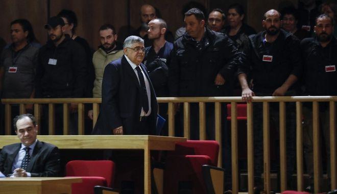 Στιγμιότυπο από την κατάθεση του Μιχαλολιάκου στη δίκη της Χρυσής Αυγής. Καταδικάστηκε σε 13 χρόνια και 6 μήνες κάθειρξη, ως αρχηγός της οργάνωσης