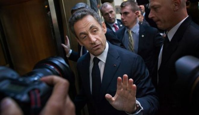 Former French President Nicolas Sarkozy arrives for an event hosted by Brazilian investment bank BTG Pactual at the Waldorf Astoria hotel in New York October 11, 2012. REUTERS/Andrew Kelly (UNITED STATES - Tags: POLITICS BUSINESS)