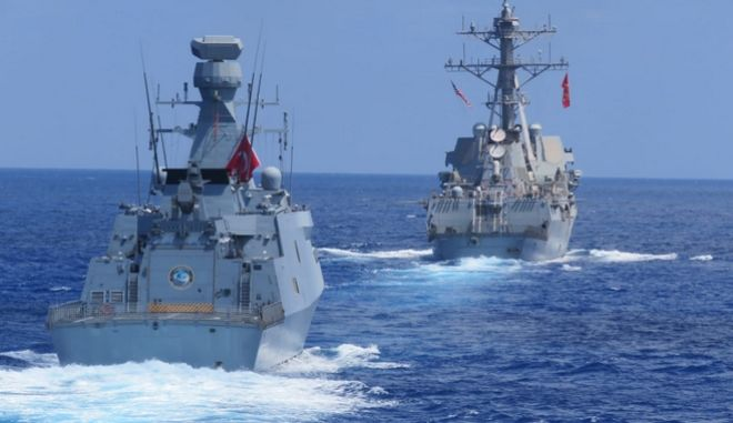 US destroyer USS Winston S. Churchill, rear, along with Turkish frigate TCG Barbaros conduct maritime trainings in the Eastern Mediterranean, Wednesday, Aug. 26, 2020, to improve coordination and interoperability.(Turkish Defense Ministry via AP, Pool)