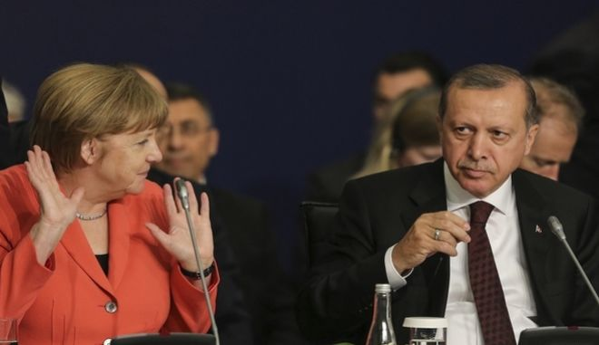 "German Chancellor Angela Merkel, left, talks to Turkey's President Recep Tayyip Erdogan during a roundtable meeting on ""Political Leadership to Prevent and End Conflicts"" at the World Humanitarian Summit in Istanbul, Monday, May 23, 2016. World leaders and representatives of humanitarian organisations from across the globe converge in Istanbul on May 23-24, 2016 for the first World Humanitarian Summit, focused on how to reform a system many judge broken. (Salih Zeki Fazlioglu/Anadolu, Pool Photo via AP)"