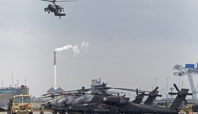 U.S. helicopters are prepared to be moved to eastern Europe after they arrived in the northern German port of Bremerhaven, Monday, Feb. 27, 2017.  The Apache helicopters are part of the operation 'Atlantic Resolve' . (Ingo Wagner/dpa via AP)