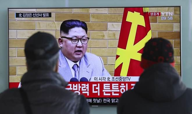 FILE - In this Jan. 1, 2018, file photo, South Koreans watch a TV news program showing North Korean leader Kim Jong Un's New Year's speech, at the Seoul Railway Station in Seoul, South Korea. On Jan. 1, 2018, Kim said in his New Years address that he is willing to send a delegation to the Pyeongchang Olympics. (AP Photo/Lee Jin-man, File)