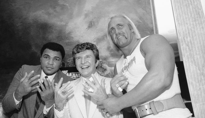 Muhammad Ali, left, Liberace, center, and Hulk Hogan get together at Madison Square Garden in preparation for their upcoming wrestling event, March 29, 1985, in New York. Ali will be guest referee and Liberace time keeper when Hulk Hogan and Mr. T, of A-Team fame, are pitted against Rowdy Roddy Piper and Paul (Mr. Wonderful) Orndorff. (AP Photo/Marty Lederhandler)