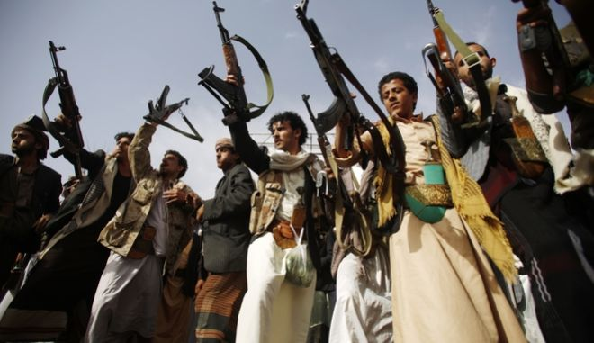 Shiite rebels known as Houthis hold up their weapons as they dance during a rally against Saudi-led airstrikes in Sanaa, Yemen, Sunday, June 14, 2015. Yemeni political groups, including the Shiite rebels known as Houthis, departed from the airport in the capital, Sanaa, on Sunday, to travel to Geneva for U.N.-led peace talks, officials said.