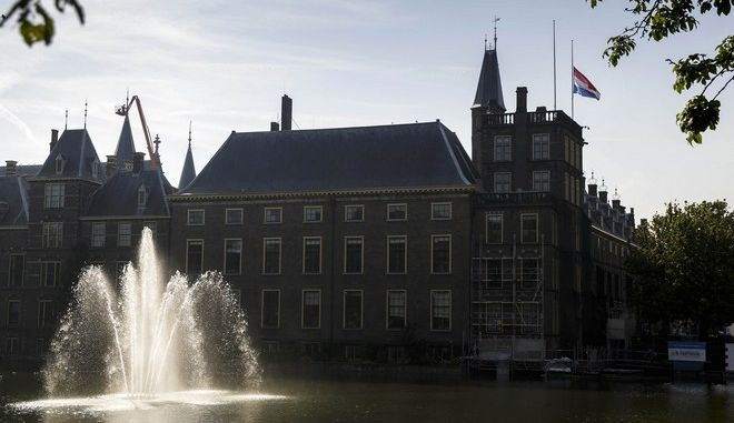 A national flag flies half-staff at Binnenhof, the seat of the Dutch government, in The Hague, Netherlands, Friday, July 18, 2014. Flags are flying half-staff across the Netherlands as the country mourns at least 154 of its citizens killed when a Malaysia Airlines passenger jet was shot down in eastern Ukraine. (AP Photo/Phil Nijhuis)