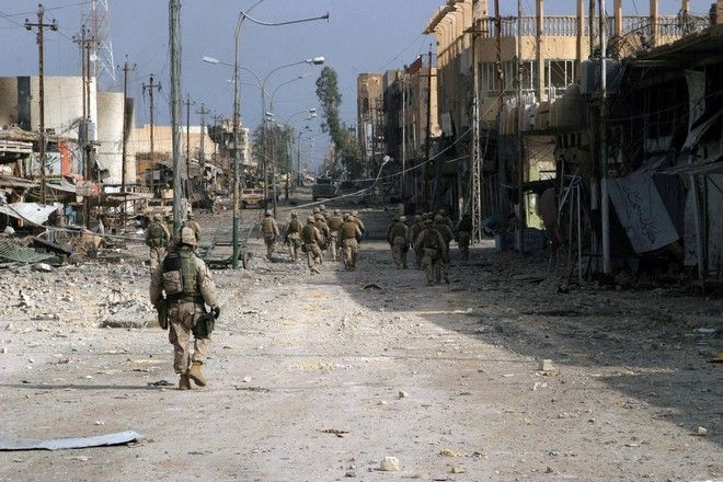 041114-M-8205V-005 Fallujah, Iraq (Nov. 15, 2004) - Iraqi Special Forces Soldiers assigned to the U.S. Marines of 2nd Squad, 3rd Platoon, L Company, 3rd Battalion, 5th Marine Regiment, 1st Marine Division, patrol south clearing every house on their way through Fallujah, Iraq, during Operation Al Fajr (New Dawn). Operation Al Fajr is an offensive operation to eradicate enemy forces within the city of Fallujah in support of continuing security and stabilization operations in the Al Anbar province of Iraq by units of the 1st Marine Division. U.S. Marine Corps photo by Lance Cpl. James J. Vooris (RELEASED)