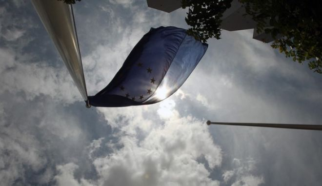 A European Union flag flies outside the Stock Exchange in Athens on Friday, May 25, 2012. Uncertainty over Greece's future in the eurozone has hammered markets ahead of June 17 general elections in the crisis-hit country. The Greek share index touched new 22-year lows, dipping below 500 points. (AP Photo/Thanassis Stavrakis)