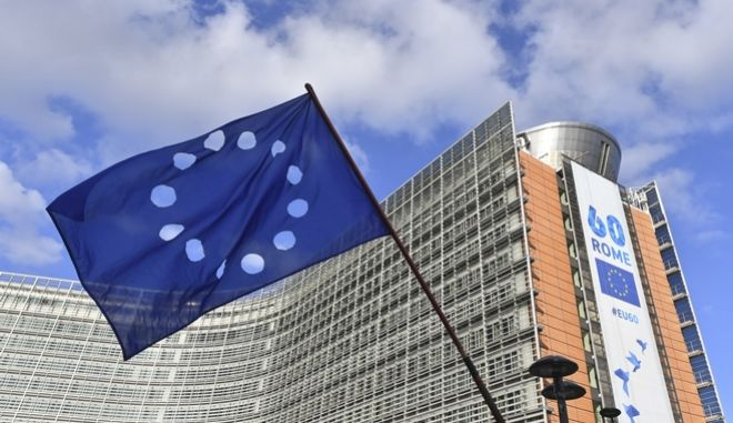 A European flag with the stars cut out is waved by a Catalonia pro-independence demonstrator in front of the European Commission headquarters in support of the ousted Catalan government in Brussels, Belgium, on Tuesday, Nov. 7, 2017. Catalan leader Carles Puigdemont is fighting extradition to Spain, where other members of the ousted Cabinet have been sent to jail while awaiting the results of a probe for allegedly weaving a strategy to secede from Spain. (AP Photo/Geert Vanden Wijngaert)