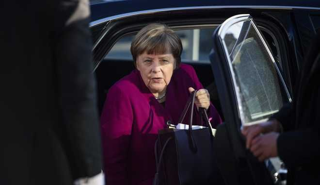 German Chancellor Angela Merkel arrives for what is supposed the last day of the coalition talks between her Christian Democratic bloc and the Social Democratic party at the CDU headquarters in Berlin, Tuesday, Feb. 6,  2018. (Gregor Fischer/dpa via AP)