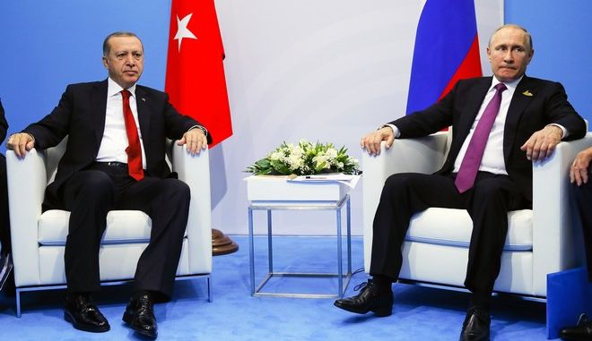 Russian President Vladimir Putin, right, and Turkish President Recep Tayyip Erdogan attend the talks at the G-20 summit in Hamburg, northern Germany, Saturday, July 8, 2017. Putin and Erdogan underlined the importance of a Syria peace deal brokered by Russia and Turkey. (AP Photo/Alexander Zemlianichenko, Pool)