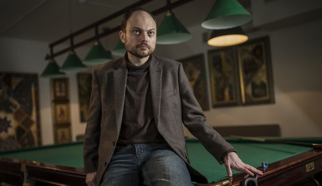 In this photo taken on Friday, Jan. 29, 2016, Vladimir Kara-Murza, 35, Russian opposition activist poses for a photo in Moscow, Russia. Russia's opposition movement struggles to rally around one unifying figure two years after Nemtsov, a former deputy prime minister, was gunned down just outside the Kremlin wall on Feb. 27, 2015. (AP Photo/Dmitri Beliakov)