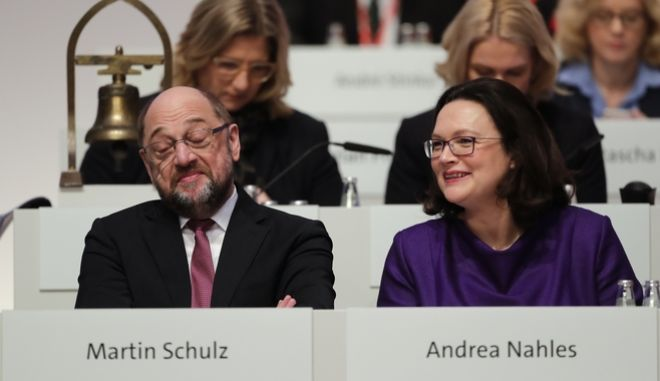 Social Democratic Party,SPD, chairman Martin Schulz, left, and faction leader Andrea Nahles attend the second day of the party's convention in Berlin, Friday, Dec. 8, 2017. (AP Photo/Markus Schreiber)