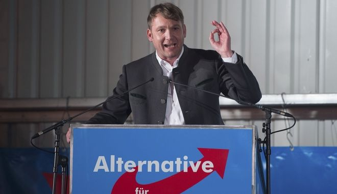 "In this Feb. 14, 2018 photo Andre Poggenburg, head of the nationalist AfD in German state of Saxony-Anhalt, speaks during a party rally in Nentmannsdorf near Pirna, eastern Germany, where he insulted Turks as camel drivers and defamed immigrants with dual passports as homeless mob that we no longer want to have here."" (Sebastian Kahnert/dpa via AP)"