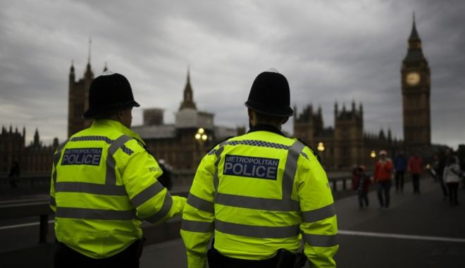 Police officers patrol Westminster Bridge with the Houses of Parliament in the background, on election day in London, Thursday, June 8, 2017. Britain voted Thursday in an election that started out as an attempt by Prime Minister Theresa May to increase her party's majority in Parliament ahead of Brexit negotiations but was upended by terror attacks in Manchester and London during the campaign's closing days. (AP Photo/Markus Schreiber)