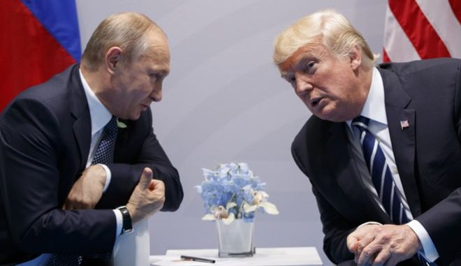 FILE - In this Friday, July 7, 2017, file photo U.S. President Donald Trump meets with Russian President Vladimir Putin at the G-20 Summit in Hamburg. A separate US-Russia-brokered truce for southern Syria, brokered by the U.S. and Russia, is meant to help allay growing concerns by neighboring Jordan and Israel about Iranian military ambitions in the area. (AP Photo/Evan Vucci, File)