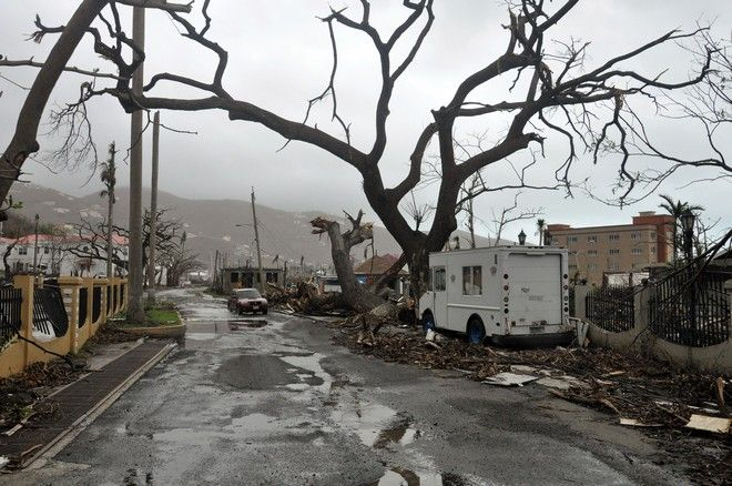 Trees stand barren and debris lays on the roadside, caused by Hurricane Maria in Road Town, on the island of Tortola, in the British Virgin Islands, early Wednesday, Sept. 20, 2017.  (AP Photo/Freeman Rogers)