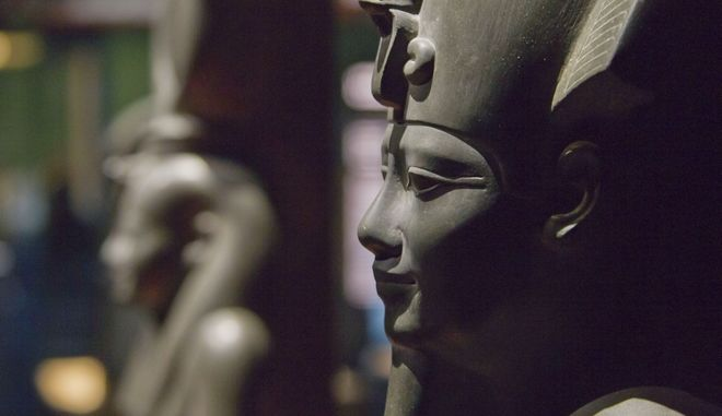 The face of  Osiris statue, Saite period, 26 dynasty, reign of Amasis (570-526 BC), is displayed at the Institut du Monde Arabe (Arab World Institute), as part of the Osiris, Sunken Mysteries of Egypt exhibition in Paris, France, Wednesday, Sept. 9, 2015.  As the cultural world decries the destruction of ancient sites in Syria, Paris' Arab World Institute defiantly celebrates the preservation of ancient culture by holding a never-before-seen exhibit of the remains of the ancient Egyptian city of Heracleion. (AP Photo/Michel Euler)
