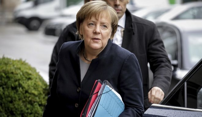 German Chancellor Angela Merkel arrives for the coalition talks between her Christian Democrats and Free Democratic party FDP and the Green party in Berlin Monday, Nov. 13, 2017. (Kay Nietfeld/dpa via AP)
