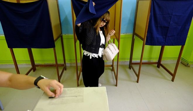 A voter exits a booth at a polling station during the parliamentary elections in southern port city of Limassol in this Mediterranean island of Cyprus, on Sunday, May 22, 2016. Cypriots elect a new parliament amid high voter disillusionment with what many see as the country's discredited political establishment. (AP Photo/Petros Karadjias)