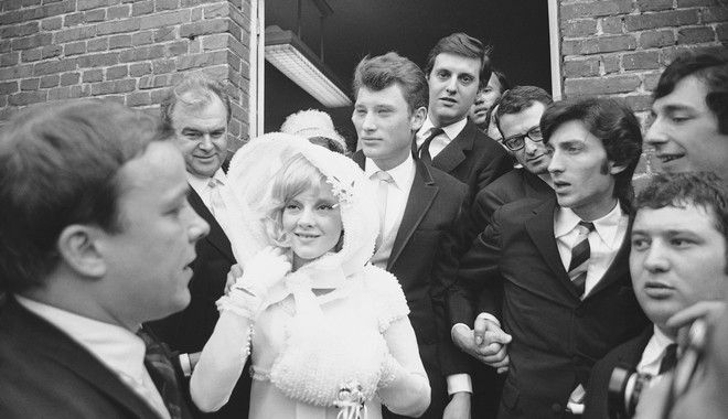 French ?Pop? singing idols Sylvie Vartan and Johnny Hallyday leave the town hall in Loconville, near Paris, France, April 12, 1965 after their civil wedding ceremony. From the town hall they pushed their way through hordes of fans and photographers to a church for the religious ceremony. (AP Photo)
