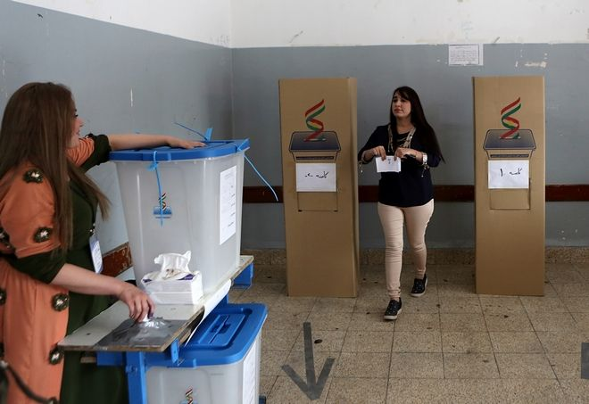 An Iraqi Kurdish woman leaves the voting booth to cast her ballot in the referendum on independence from Iraq in Irbil, Iraq, Monday, Sept. 25, 2017. Iraq's Kurdish region vote in a referendum on whether to secede from Iraq. (AP Photo/Khalid Mohammed)