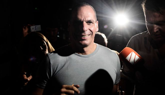 """ATHENS, GREECE - JULY 05:  Greek Finance Minister Yanis Varoufakis leaves his office as Greek voters are expected to vote no in the Greek austerity referendum, on July 5, 2015 in Athens, Greece. The people of Greece are going to the polls to decide if the country should accept the terms and conditions of a bailout with its creditors. Greek Prime Minister Alexis Tsipras is urging people to vote """"a proud no"""" to European creditors' proposals, and """"live with dignity in Europe"""". 'Yes' campaigners believe that a no vote would mean financial ruin for Greece and the loss of the Euro currency.  (Photo by Milos Bicanski/Getty Images)"""