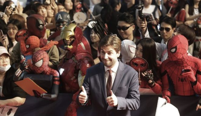 """Director Jon Watts poses during a promotional event for his latest film """"Spider-Man: Homecoming"""" in Seoul, South Korea, Sunday, July 2, 2017. The film will be released in South Korea on July 5. (AP Photo/Ahn Young-joon)."""