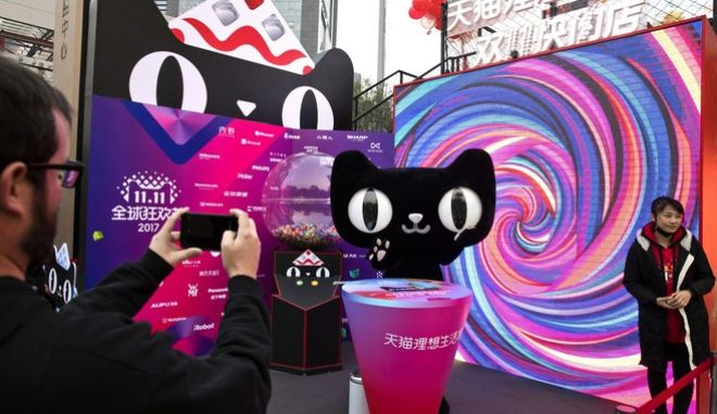 """A mascot for Tmall, an online shopping website owned by Alibaba, promotes Singles Day in Beijing, China, Monday, Nov. 6, 2017. On Nov. 11, online shoppers are expected to spend billions of dollars on """"Singles' Day,"""" a quirky holiday that has grown into the world's busiest day for e-commerce. (AP Photo/Ng Han Guan)"""