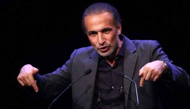 Muslim scholar Tariq Ramadan delivers a speech during a French Muslim organizations meeting in Lille, northern France, Sunday Feb.7, 2016. (AP Photo/Michel Spingler)