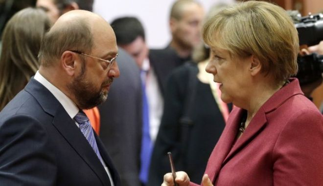 German Chancellor Angela Merkel, right, speaks with European Parliament President Martin Schultz during a round table meeting at an EU summit in Brussels, on Thursday, Oct. 23, 2014. EU leaders will gather Thursday for a two-day summit in which they will discuss Ebola, climate change and the economy. (AP Photo/Yves Logghe)