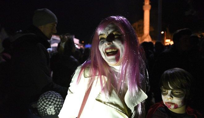 """Festival goers with painted faces and wearing costumes to spook locals on what's called """"Bocuk gecesi,"""" or """"Bocuk night"""", march in the village of Camlica, in the northwestern province of Edirne, Turkey, some 50km from the Greek border, late Saturday, Jan. 6, 2018, to celebrate the Turkish version of Halloween. According to folklore, """"Bocuk"""" is an invisible entity that appears on the coldest night of the year to wreak havoc _ it's believed to bring ill health and chaos. The only way to keep """"Bocuk"""", is to eat a traditional pumpkin dessert, according to the legend, which dates back to Medieval times and came to Turkey from the neighbouring Balkans. (AP Photo/Ergin Yildiz)"""