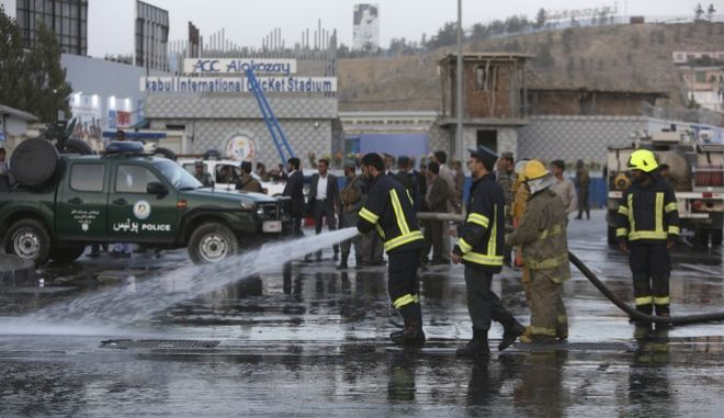 Afghan firefighters work at the site of a suicide attack outside a cricket stadium, in Kabul, Afghanistan, Wednesday, Sept. 13, 2017. The bomber struck outside a cricket stadium during a match in Afghanistan's capital Wednesday, killing at least three people and wounding 12 others, officials said. (AP Photo/Rahmat Gul)