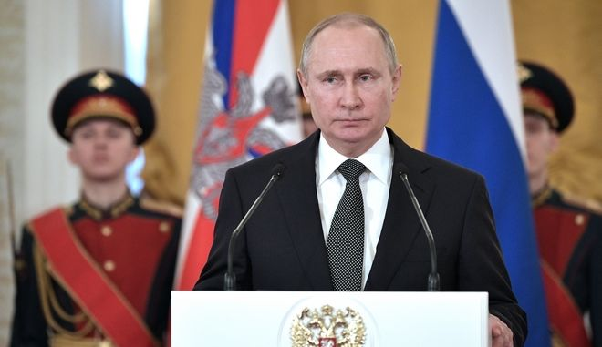 Russian President Vladimir Putin speaks during a ceremony of presenting national awards marking the Defender of the Fatherland Day in the Kremlin in Moscow, Russia, Friday, Feb. 23, 2018. (Alexei Nikolsky, Sputnik, Kremlin Pool Photo via AP)
