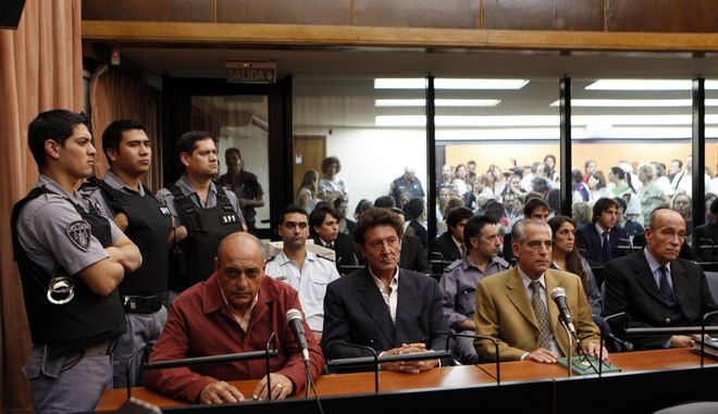 Former army intelligence operative Raul Guglielminetti, sitting left, former agents of Argentina's intelligence agency SIDE, Honorio Ruiz, sitting second from left, and Eduardo Ruffo, sitting third from left, and former Army Gen. Eduardo Rodolfo Cabanillas sit in court before their sentencing in Buenos Aires, Argentina, Thursday March 31, 2011.  Cabanillas was sentenced to life in prison, Guglielminetti to 20 years in prison, while Ruiz and Ruffo where sentenced to 25 years in prison, as they were charged for illegal imprisonment and torture of 65 prisoners during the Dirty war in the Orletti garage, a tactical operations center for Operation Condor, a coordinated effort by South America's dictatorships to eliminate dissidents who sought refuge in neighboring countries. (AP Photo/Natacha Pisarenko)
