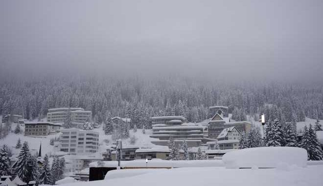 Buildings are covered with snow near the congress center where the annual meeting of the World Economic Forum takes place in Davos, Switzerland, Monday, Jan. 22, 2018. The meeting brings together entrepreneurs, scientists, chief executives and political leaders from Jan. 23 to 26. (AP Photo/Markus Schreiber)