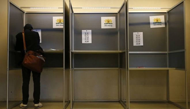 A person casts their ballot for the Dutch general election at a polling station in The Hague, Netherlands, Wednesday, March 15, 2017. (AP Photo/Peter Dejong)