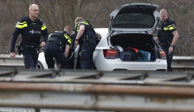 Dutch police search a vehicle on the A4 motorway near The Hague, Netherlands, Friday, March 10, 2017. Dutch newspapers report that one of the occupants of the vehicle was carrying a weapon. (AP Photo/Peter Dejong)
