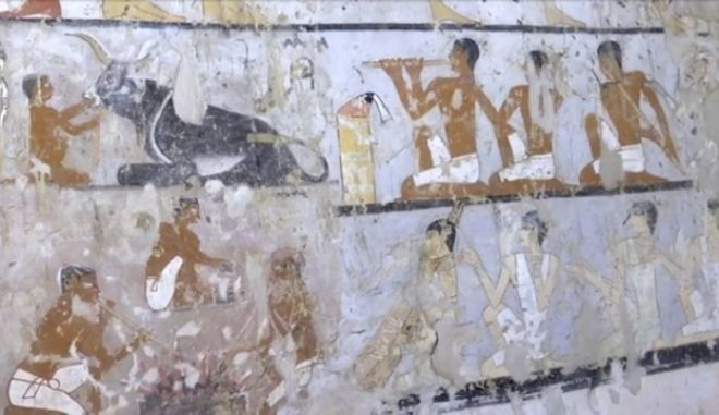 This image taken from video on Saturday, Feb. 3, 2018, shows wall paintings inside a 4,400-year-old tomb near the pyramids outside Cairo, Egypt. Egypt's Antiquities Ministry announced the discovery Saturday and said the tomb likely belonged to a high-ranking official known as Hetpet during the 5th Dynasty of ancient Egypt. The tomb includes wall paintings depicting Hetpet observing different hunting and fishing scenes.  (AP Photo/APTN)