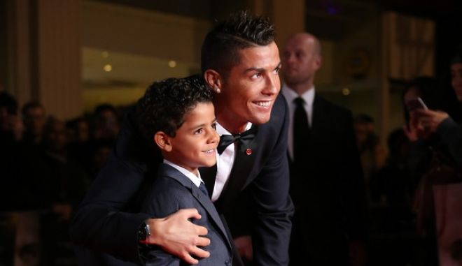Cristiano Ronaldo, left, and his son Cristiano Ronaldo Junior  pose for photographers upon arrival at the world premiere of the film 'Ronaldo, in London, Monday, Nov. 9, 2015. (Photo by Joel Ryan/Invision/AP)