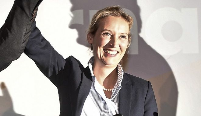 AfD top candidate Alice Weidel is celebrated in the flashlights during the election party of the nationalist 'Alternative for Germany', AfD, in Berlin, Germany, Sunday, Sept. 24, 2017, after the polling stations for the German parliament elections had been closed. (AP Photo/Martin Meissner)