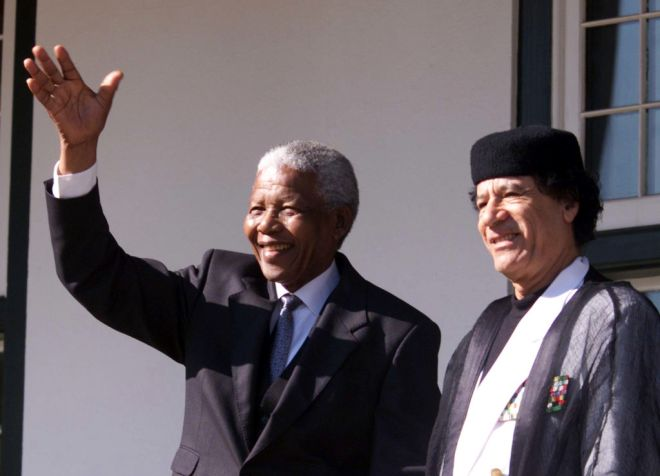 South African President Nelson Mandela greets Libyan leader Muammar Gaddafi at the Tuynhuis at Cape Town airport June 13. Gaddafi arrived in South Africa on Sunday as retiring President Nelson Mandela's last official guest.  PA/FMS - RTRQ033