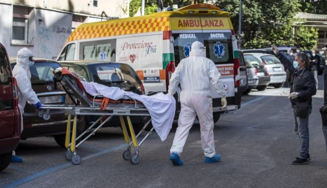 """One of the hosts of residence for elderly """"Clinica Latina"""" which  resulted positive for COVID-19 is being transported to the Spallanzani hospital, after various cases of the coronavirus outbreak were discovered in this nursing home in Rome Saturday, May 2, 2020. (Roberto Monaldo/LaPresse via AP)"""