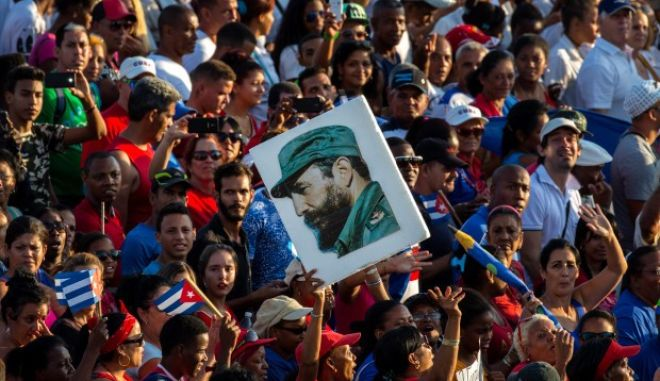 People with an image of the Cuban leader Fidel Castro march during the May Day parade at Revolution Square, in Havana, Cuba, Sunday, May 1, 2016.  Thousands of people converged on the square for the traditional May Day march. (AP Photo/Ramon Espinosa)