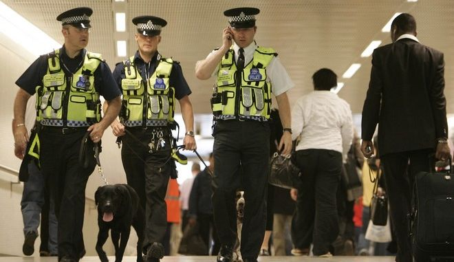 British Transport Police officers with the Explosive Search Dog Section patrol the refurbished King's Cross Underground station, in central London, Wednesday June 21, 2006. A year after  July 7, 2005, when suicide bombers brought carnage and chaos to three Underground trains and one of the city's iconic buses, life in the capital has returned to normal _ almost. (AP Photo/Lefteris Pitarakis)