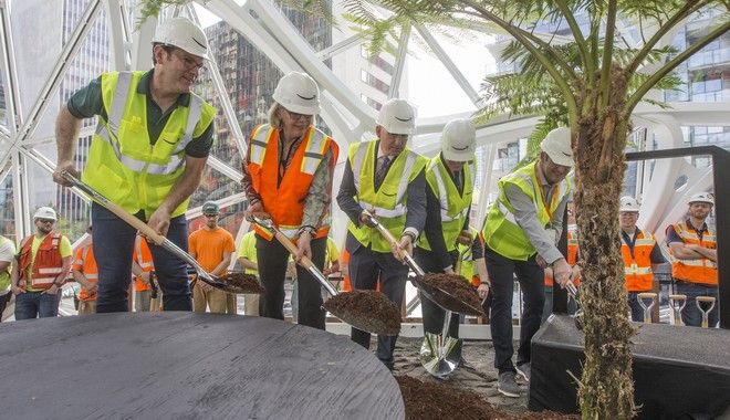 IMAGE DISTRIBUTED FOR AMAZON - From left, Amazon horticulturist Ron Gagliardo, Seattle City Councilmember Sally Bagshaw, King County Executive Dow Constantine, Downtown Seattle Association President and CEO Jon Scholes and Amazon Director of Global Real Estate and Facilities John Schoettler shovel dirt during the ceremonial first planting at The Spheres on the Amazon campus on Thursday, May 4, 2017, in Seattle. (Stephen Brashear/AP Images for Amazon)