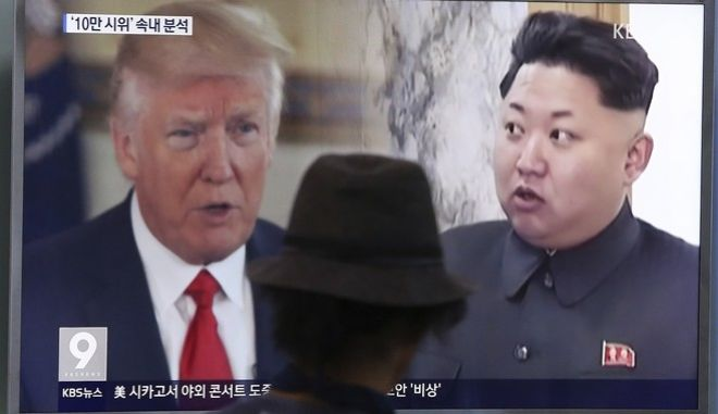 In this Thursday, Aug. 10, 2017, file photo, a man watches a television screen showing U.S. President Donald Trump, left, and North Korean leader Kim Jong Un during a news program at the Seoul Train Station in Seoul, South Korea. North Korea has announced a detailed plan to launch a salvo of ballistic missiles toward the U.S. Pacific territory of Guam, a major military hub and home to U.S. bombers. If carried out, it would be the North's most provocative missile launch to date. (AP Photo/Ahn Young-joon, File)