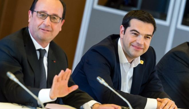 French President Francois Hollande, left, and Greek Prime Minister Alexis Tsipras participate in a meeting at an EU summit at the European Council building in Brussels on Monday, June 22, 2015. Heads of state in the eurogroup meet in Brussels Monday for a special summit to discuss the financial crisis with Greece. (AP Photo/Geert Vanden Wijngaert)