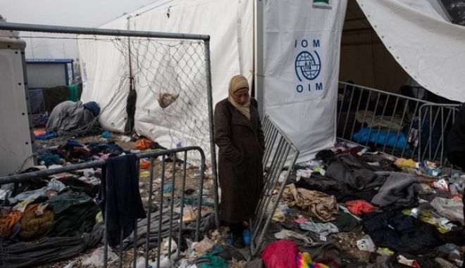 More than 13000 people are stranded near the Greek village of Idomeni under bad weather conditions as the Greek-FYRO Macedonia border remains closed for second day on March 8, 2016.