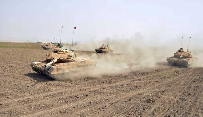 In this photo taken Saturday, Sept. 23, 2017, Turkish army tanks move during maneuvers in Silopi, near Habur border gate with Iraq, southeastern Turkey. The Turkish parliament on Saturday renewed a bill allowing the military to intervene in Iraq and Syria if faced with national security threats  a move seen as a final warning to Iraqi Kurds to call off their Monday independence referendum. (Turkish Military/Pool Photo via AP)