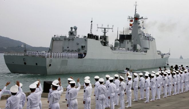 In this photo released by China's Xinhua News Agency, a Chinese naval fleet including two destroyers and a supply ship from the South China Sea Fleet set off from Sanya, a coastal city of South China's Hainan Province on Friday, Dec. 26, 2008. Chinese warships, armed with special forces, guided missiles and helicopters, set sail Friday for anti-piracy duty off Somalia, the first time the communist nation has sent ships on a mission that could involve fighting so far beyond its territorial waters. (AP Photo/Xinhua, Zha Chunming)
